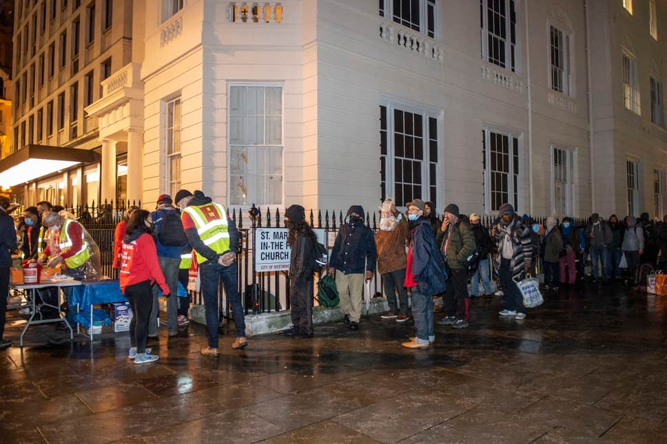 This is London in 2020 as hundreds desperately queue for a meal